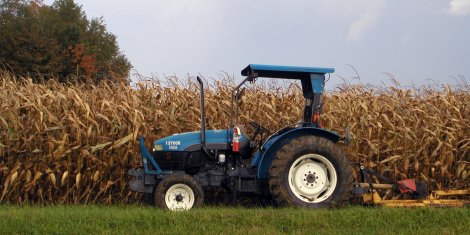 tractor and a corn field